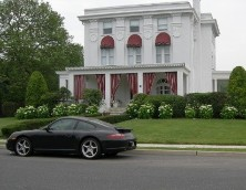 Porsche in front of luxury home